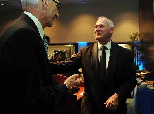 Dr. Roy Church, right, talks with keynote speaker Professor  Michael Porter at a reception for The Legacy of Leadership at LCCC on Apr. 25.  Steve  Manheim